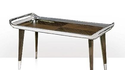 Keno Bros. tray table The Keno Bros. streamlined Chic tray table uses maple and louro preto veneers trimmed with stainless steel.