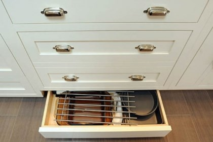 Kick-plate drawers Kick-plate drawers along the floor open at the touch of a hand or toe.