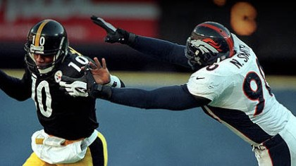Kordell Stewart and Neil Smith Steelers quarterback Kordell Stewart tries to elude Broncos defensive end Neil Smith during the 1997 AFC Championship Game at Three Rivers Stadium.