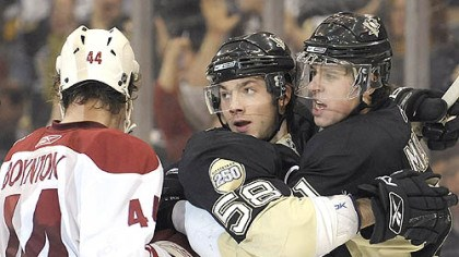Kris Letang and Evgeni Malkin Kris Letang celebrates his goal with Evgeni Malkin in the third period last night.