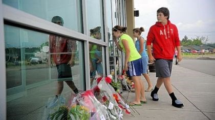 LA Fitness shooting, the day after From left, Amanda Tirmble, 13, Elizabeth Scurich, 13, and Zach Young, 14, look into the entryway of Bridgeville's LA Fitness, the site of the fatal shooting of three woman, the day after it occurred.