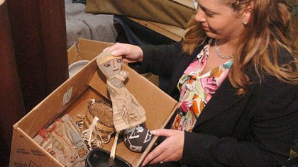 Larry Johnson's gift Kim Kitchen, director of planned giving at Juniata College, sorts through some of the personal items from the estate of Larry Johnson.