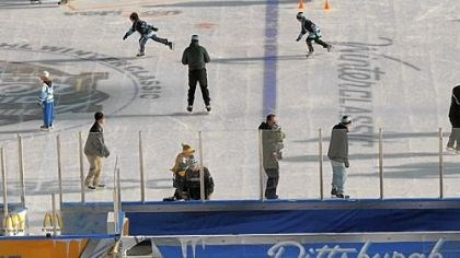 Last skate As skaters take to the ice for the last time, Heinz Field workers dismantle the on-field rink Sunday morning after the NHL Winter Classic.