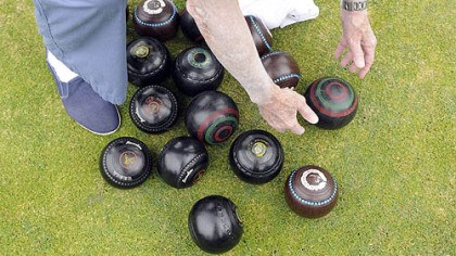lawn bowling balls Ed Gannon of Regent Square picks his lawn bowling ball from the pile.