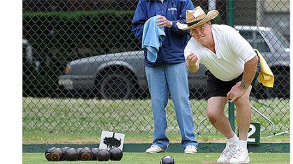 lawn bowling Rich Hoffman of Greenfield lets a ball in Frick Park.
