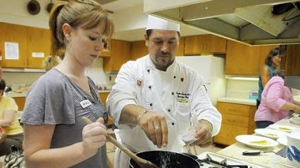 Learning 1 Amanda Petrovich of Fox Chapel helps Stephen J. Grottenthaler, executive chef of Pittsburgh Field Club, in a cooking class at Fox Chapel Area High School.