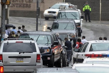 Leaving the scene People cross DeSoto Street as they leave the scene at the shootings this afternoon at Western Psychiatric Institute and Clinic in Oakland.