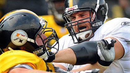 Lentz Offensive guard Matt Lentz (right) blocks Kyle Clement.