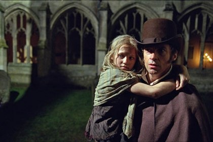 "'Les Miserables' Isabelle Allen is young Cosette and Hugh Jackman is Jean Valjean in Tom Hooper's film version of ""Les Miserables."""