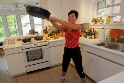 Leslie Bonci Leslie Bonci, Sports Nutrition Program director at the UPMC Center for Sports Medicine, exercises using an iron skillet in her kitchen.