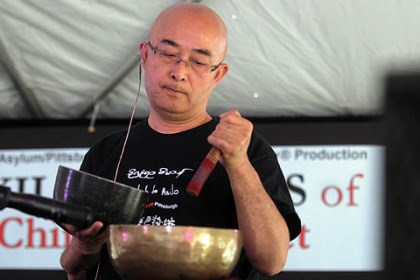 Liao Yiwu at Exiled Voices of China and Tibet event Liao Yiwu is a Chinese author, musician and poet, who ended his presentation playing Tibetian bowls.