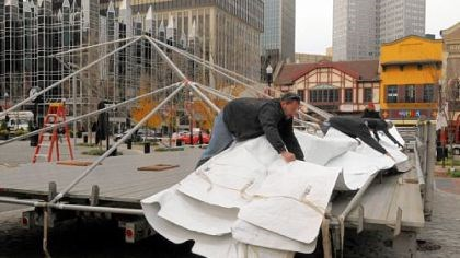 Light Up Night begins The tarp is pulled into place Thursday for the stage at Market Square for Light Up Night. Entertainment in the square begins at 5 p.m. Friday. Events at other Downtown venues also start at dusk, culminating with fireworks over the Clemente Bridge at 9:38 p.m. Noontime events for the holiday season will take place at the City-County Building and at U.S. Steel Tower Plaza.