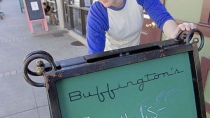 Like fries with that investigation? Katie Keller erases a sign Saturday promoting a Roethlis-burger lunch special at Buffington's, one of the bars Ben Roethlisberger went to Thursday in Milledgeville, Ga.