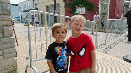 Little fans Auggie Mazza, left, and cousin D.J. Noel came from Morningside to check out the movie activities.