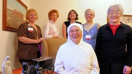 Little Sisters of the Poor Those traveling to Rome for the ceremony from the Little Sisters of the Poor in Pittsburgh's Brighton Heights neighborhood include Sister Rosemarie Yao, seated, and standing, from left, Cathy Jo McConnell, Lee Comport, Kathleen Baker, Valerie Beam and Machiko Seto. On the table is a replica of the order's horse wagon that used to ply Pittsburgh streets.
