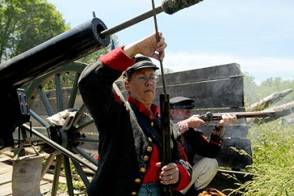 Loading rifle Cathy Griffey of Moon, a member of Carpenter's Battery, loads a rifle during the Battle of Bedford, a Civil War re-enactment at Old Bedford Village in Bedford, Pa.