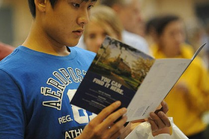 Looking at La Roche David Lee of Wexford studies a brochure at a college fair for high school students at La Roche College in McCandless.