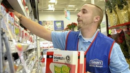 Lowe's Home Improvement Assistant store manager Joshua Steele stocks the last of the 100-watt incandescent bulb inventory Tuesday at Lowe's Home Improvement on Waterfront Drive in Munhall.