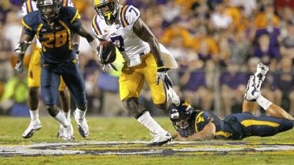 LSU's Patrick Peterson runs by West Virginia's Terence Garvin LSU's Patrick Peterson runs by West Virginia's Terence Garvin, left, and Trevor Demko to score on a 60-yard punt return midway through the second quarter Saturday night in Baton Rouge, La.