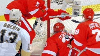 Lucky rather than good? What's that about preferring to be lucky rather than good? The puck ends up on the back of Detroit goalie Chris Osgood late in last night's game in Detroit.