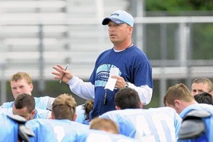 Lyons Central Valley coach Mark Lyons addresses his team during a preseason session last year. He has been suspended for two games.