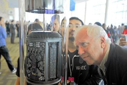 Mac Pro Mike Mihalik views the new cylindrical Mac Pro on display Monday during Apple's Worldwide Developer Conference at Moscone Center in San Francisco. Apple also unveiled its hotly anticipated iTunes Radio Service, as the iconic maker of the iPhone moved to challenge large streaming music operators.