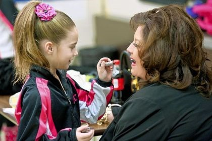 "Mackenzie Ziegler and Abby Lee Miller ""Dance Moms"" star Abby Lee Miller shares some makeup tips with one of her students, Mackenzie Ziegler."