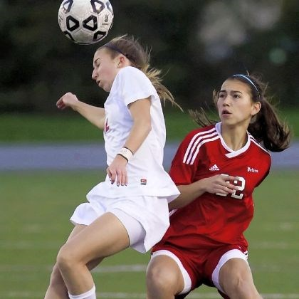 Madison Santo Peters Township's Madison Santo, right, helped the Lady Hounds win a championship.