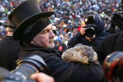 Magical marmot predicts spring in six weeks Groundhog Club Co-handler John Griffiths holds the weather predicting groundhog, Punxsutawney Phil, as he is surrounded by photographers at Groundhog Day festivities in Punxsutawney this morning.