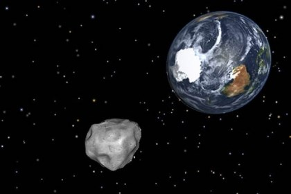 Making a pass A simulation of asteroid 2012 DA14 approaching as it passes through the Earth-moon system this Friday.