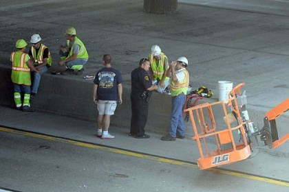man crushed by lift Investigators examine the scene on E. Ohio Street where a man was crushed by a lift this afternoon.
