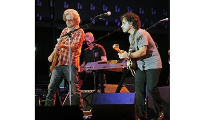 """Maneater."" Hall and Oates open their sold out concert with the 1977 hit ""Maneater."""