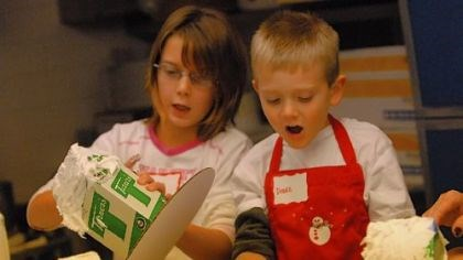 Maranda Scherer and Drake Lemasters Maranda Scherer, 9, of West Mifflin, and Drake Lemasters, 5, of Lincoln Place, take part in the gingerbread house class at Rania's Catering in Mt. Lebanon. Increasing numbers of boys are interested in cooking and baking.