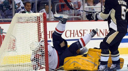 Marc-Andre Fleury Washington Capitals' Michael Nylander, left, of Sweden, falls over Penguins goalie Marc-Andre Fleury as Darryl Sydor (5) looks on during the first period last night in Washington.