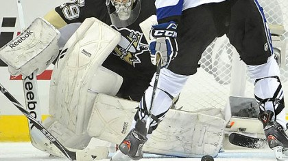 Marc-Andre Fleury Penguins goaltender Marc-Andre Fleury makes a save on Lightning goaltender Vincent Lecavalier in the third period of Wednesday's game at Consol Energy Center.