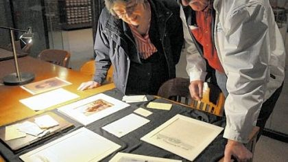 Marguerite Hartl and husband Max Marguerite Hartl, named after her great-aunt Marguerite Westinghouse -- wife of George Westinghouse, Jr. -- and her husband Max from Mt. Prospect, IL look over documents of the family during their reunion Saturday.