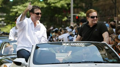 Mario Lemieux and Ron Burkle Mario Lemieux, left, and Ron Burkle ride together in the Stanley Cup parade last June.