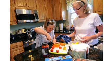 Marisa and Nancy Murray Marisa Murray, left, 38, and her mother, Nancy, work together preparing veggies for their dinner salads in the kitchen of their home in Bethel Park.