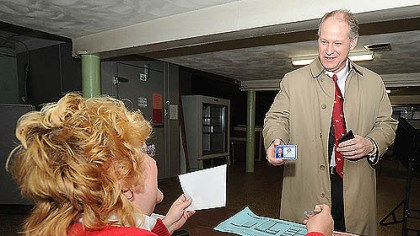 Mark Critz voter ID Congressman Mark Critz shows his photo ID to Kelly Swanson, minority inspector at precinct 17-2, as he prepares to vote today in Johnstown, Cambria County.