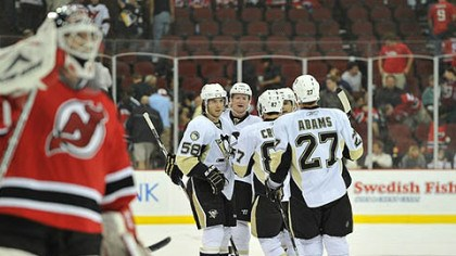 Martin Brodeur, Paul Martin, Sidney Crosby, Craig Adams, Kris Letang and Chris Kunitz Devils goaltender Martin Brodeur skates back to goal as Penguins defenseman, Paul Martin is congratulated after scoring an empty net goal in the third period by teammates Kris Letang, Chris Kunitz, Sidney Crosby and Craig Adams Monday at the Prudential Center in Newark, N.J.