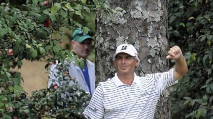 Masterful Performance Fred Couples examines his shot before hitting from behind the bushes off the 10th fairway in the first round of the Masters Thursday in Augusta, Ga.
