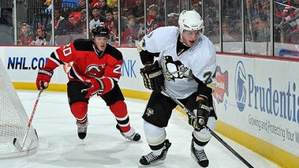 Matt Cooke Penguins forward Matt Cooke challenged for possession of the puck by Devils defenseman Matt Taormina during the third period.
