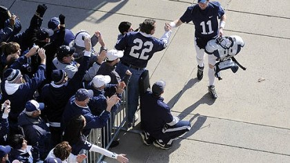 Matt McGloin Penn State quarterback Matt McGloin greets fans as he enters Beaver Stadium before his team's game against Nebraska today.