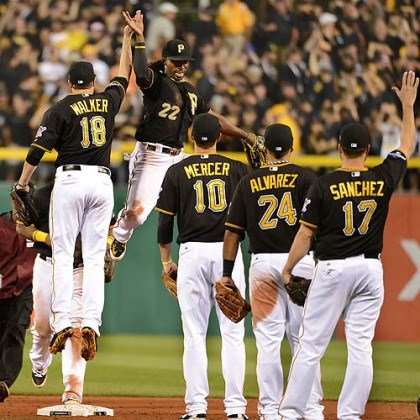 McCutchen jumpin Pirates outfielder Andrew McCutchen leaps high in the air getting a high five from Neil Walker at PNC Park.