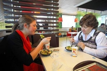 McDonald's Aimie Zvosec of Chicago, left, and Dina Phillip of Naperville dine on salads from the McDonald's dollar menu last month in Oak Brook, Ill. McDonald's will be introducing new items for the dollar menu.