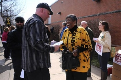 mckeesport lady McKeesport committeewoman Laura Jenkins gets some candidate information from Joe Bendel as she enters the IBEW building on the South Side to vote during the Allegheny County Democratic Committee endorsement meeting Sunday.