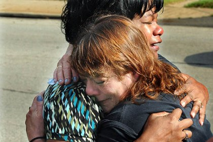 McKeesport reaction 1 Deborah Legette of McKeesport embraces Varlene Cook, mother of victim Brian Cook. He died in the early morning shooting.