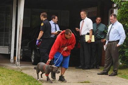 McKeesport scene Family dog Marley is led from the house during the investigation.