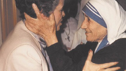 Meeting with Mother Teresa Mother Teresa embraces Gwen Coniker in 1985 before the nun recorded teaching programs for the Conikers' ministry. The two candidates for sainthood shared a deep devotion to St. Louis de Montfort.