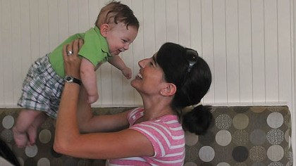 Melisssa Bowman and Cameron Melissa Bowman keeps her son Cameron, 4 months, occupied while she has brunch with her husband Karl and their daughter Emma at The Porch at Schenley.